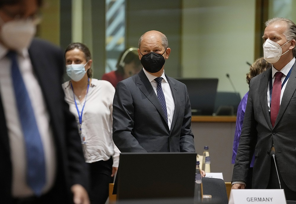 German Finance Minister Olaf Scholz, center, attends a meeting of Eurogroup finance ministers in the European Council building in Brussels on Monday, July 12, 2021 (AP Photo / Virginia Mayo)
