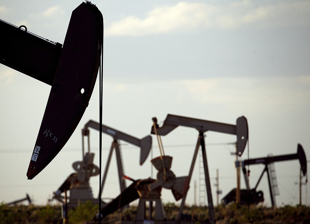 FILE - In this April 24, 2015, file photo, pumpjacks work in a field near Lovington, N.M. The Biden administration has approved thousands of drilling permits since taking office despite a campaign pledge to end fracking on federal land. (AP Photo/Charlie Riedel, File)