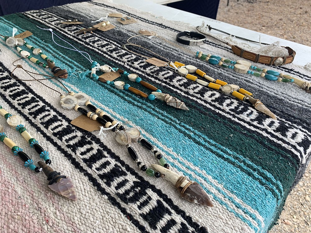 Sally Carroll/Special to the McDonald County Press Carlos Martinez creates jewelry crafted from antler buttons, arrowheads, beads and more. He sells his one-of-a-kind jewelry and other handcrafted items at the Farmers Market at Sims Corner on Saturdays.