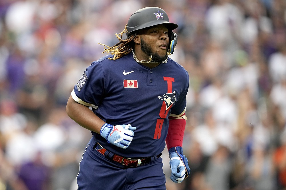 American League's Vladimir Guerrero Jr., of the Toronto Blue Jays, runs out his solo home run during the third inning of the MLB All-Star baseball game, Tuesday, July 13, 2021, in Denver. (AP Photo/David Zalubowski)