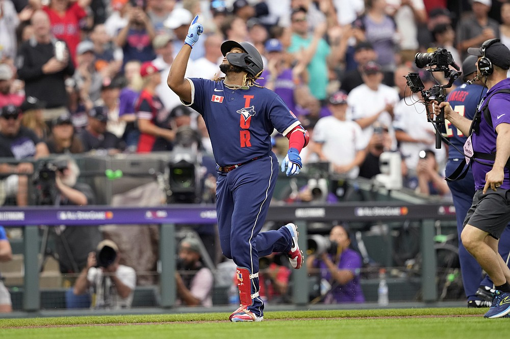 American League's Vladimir Guerrero Jr., of the Toronto Blue Jays, celebrates his solo home run during the third inning of the MLB All-Star baseball game, Tuesday, July 13, 2021, in Denver. (AP Photo/David Zalubowski)