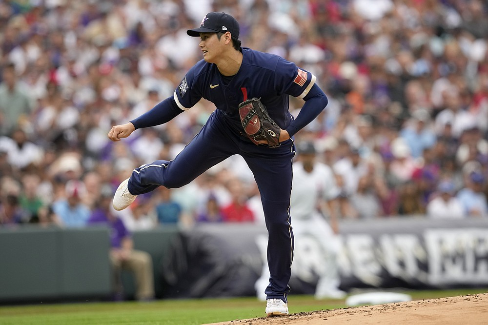 American League's starting pitcher Shohei Ohtani, of the Los Angeles Angeles, throws during the first inning of the MLB All-Star baseball game, Tuesday, July 13, 2021, in Denver. (AP Photo/David Zalubowski)
