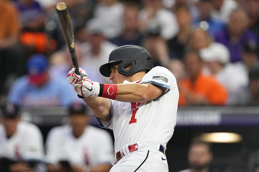 National League's J.T. Realmuto, of the Philadelphia Phillies, follows through on his solo home run during the fifth inning of the MLB All-Star baseball game, Tuesday, July 13, 2021, in Denver. (AP Photo/Jack Dempsey)