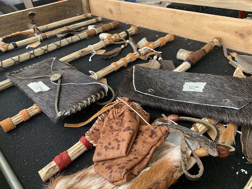 Sally Carroll/Special to the McDonald County Press Carlos Martinez creates handcrafted peace pipes, knives and jewelry to reflect his Apache heritage. His wife, Kelly, creates leather purses. They sell their items at the Farmers Market at Sims Corner on Saturdays.