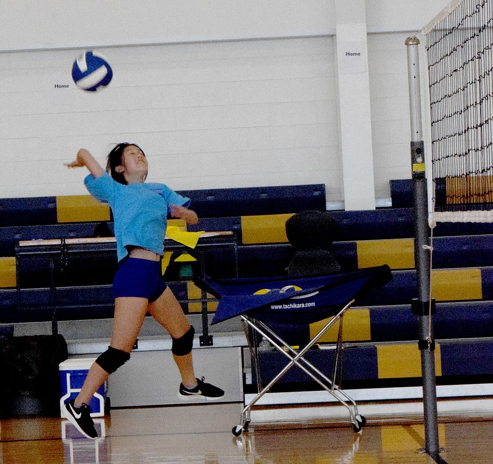 Westside Eagle Observer/MIKE ECKELS McKenzie Thao fires the ball over the net during the Thursday morning junior high Lady Bulldog volleyball practice in Decatur.