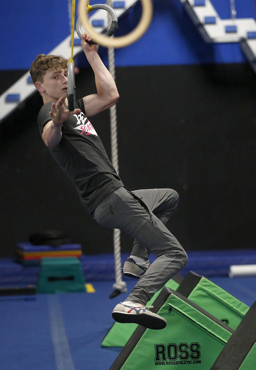 Bentonville West High School student Owen Dyer, 16, a competitor in the new Ninja Warrior's teen category reaches for a hoop as he trains Tuesday, July 6, 2021, at Flip Side Ninja Park Lowell. Check out nwaonline.com/210711Daily/ and nwadg.com/photos for a photo gallery.(NWA Democrat-Gazette/David Gottschalk)