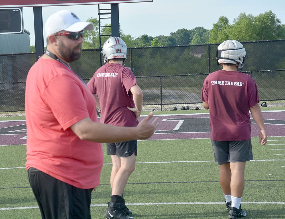 Graham Thomas/Herald-Leader Siloam Springs assistant coach Justin Wood gives instructions to the Panthers during a special teams segment of Thursday's workout session.