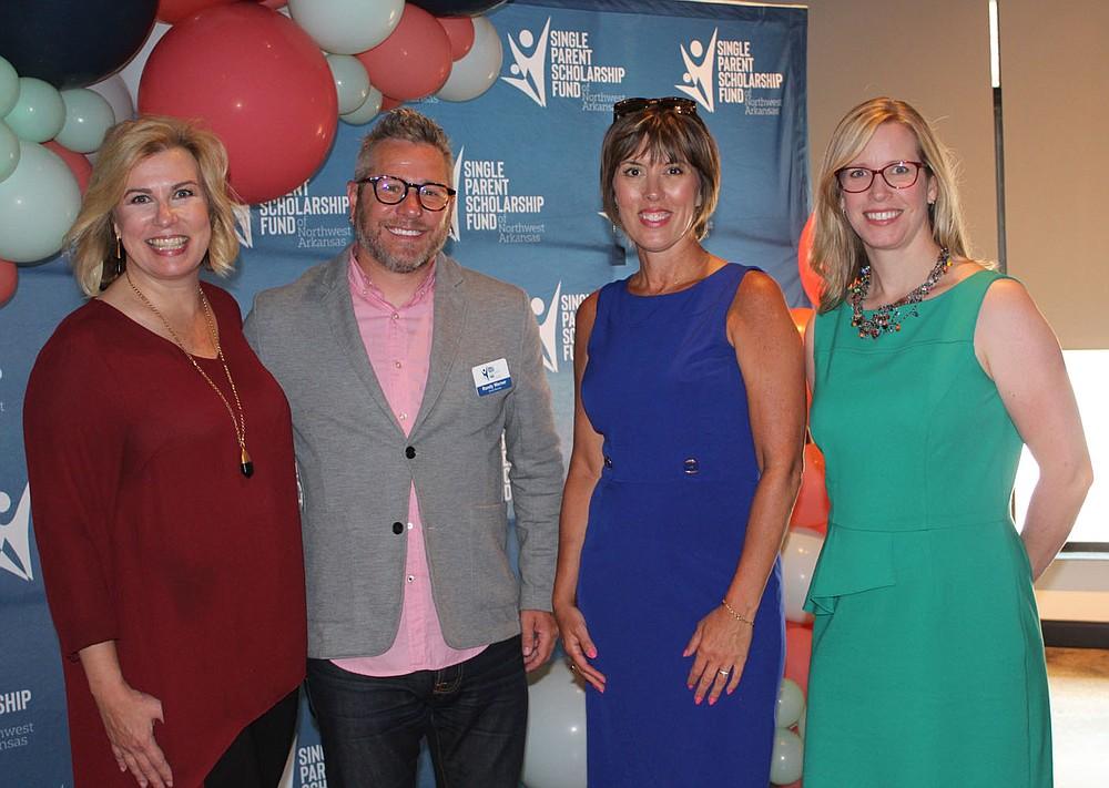 Blake Woolsey (from left), Randy Werner, Jody Dilday and Emily Ironside visit at the SPSFNWA merger celebration. (NWA Democrat-Gazette/Carin Schoppmeyer)