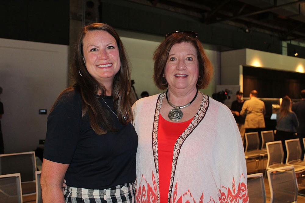 Brittney Duke (left) and Karen Parker celebrate with SPSFNWA.  (NWA Democrat-Gazette/Carin Schoppmeyer)