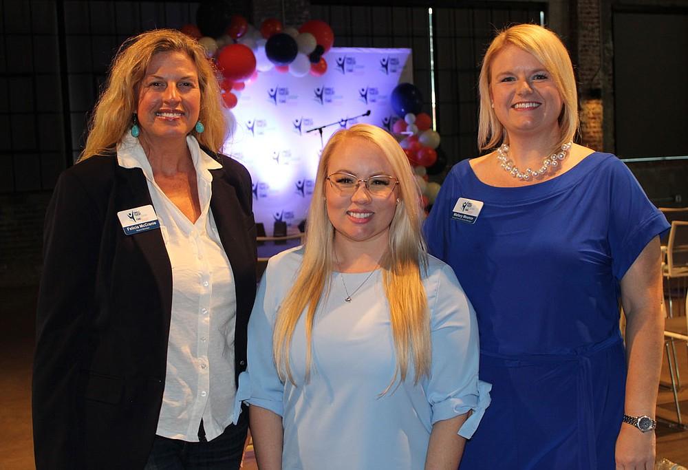 Felicia McCranie (from left), Heather Hodge and Mallory Mounce gather at the merger celebration.  (NWA Democrat-Gazette/Carin Schoppmeyer)
