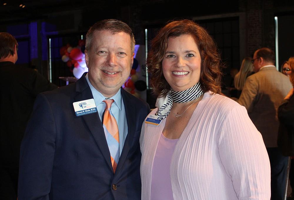 Steven and Christina Hinds stand for a photo at the merger celebration.  (NWA Democrat-Gazette/Carin Schoppmeyer)