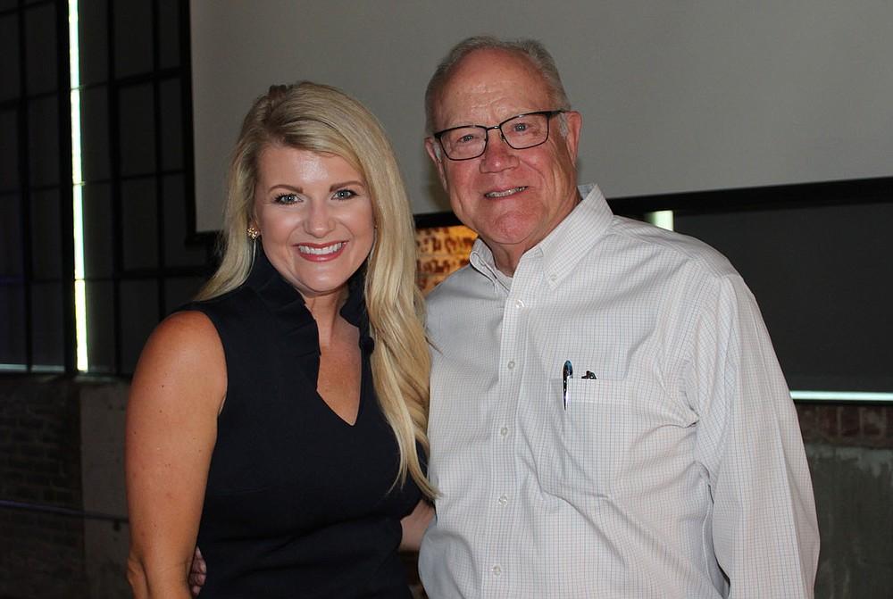 Natalie Bartholomew and Jim Crouch visit at the SPSFNWA celebration.  (NWA Democrat-Gazette/Carin Schoppmeyer)
