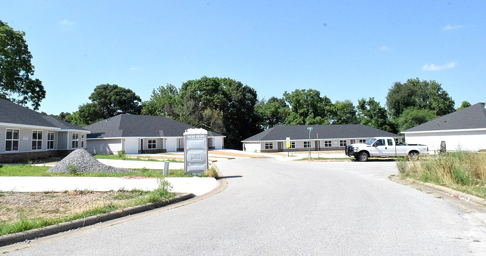 Westside Eagle Observer/MIKE ECKELS Four new multi-family apartment buildings on a new street off Hidden Springs Avenue in western Decatur near completion and soon will be available for occupancy. The 26 unit complex is part of the recent housing boom that started three years ago.