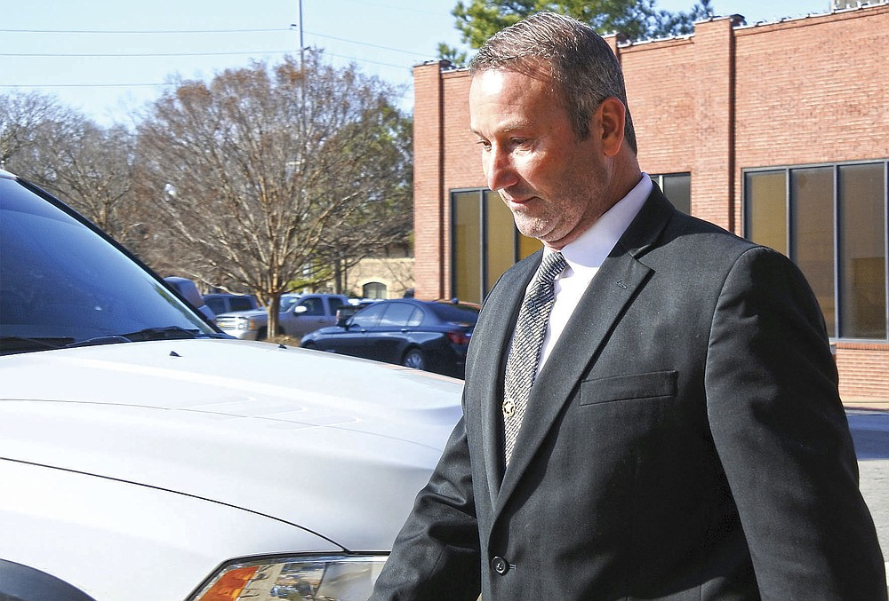 Franklin County Sheriff Anthony Boen walks to his vehicle after his arraignment in United States District Court in Fort Smith Tuesday, Dec. 17, 2019.