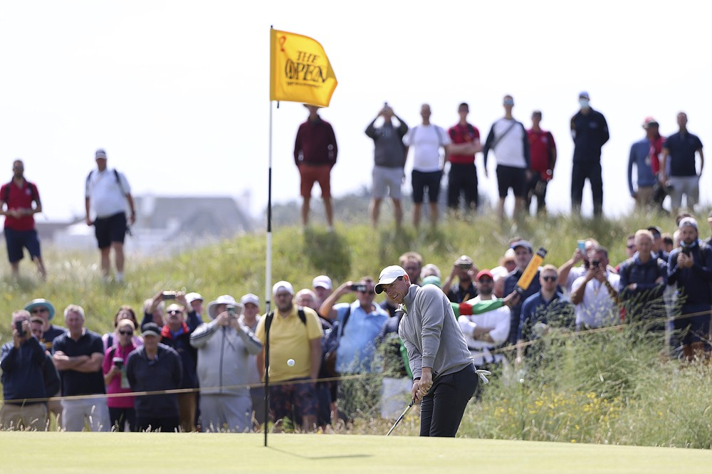 Northern Ireland's Rory McIlroy chips onto the 2nd green during the second round of the British Open Golf Championship at Royal St George's golf course Sandwich, England, Friday, July 16, 2021. (AP Photo/Ian Walton)