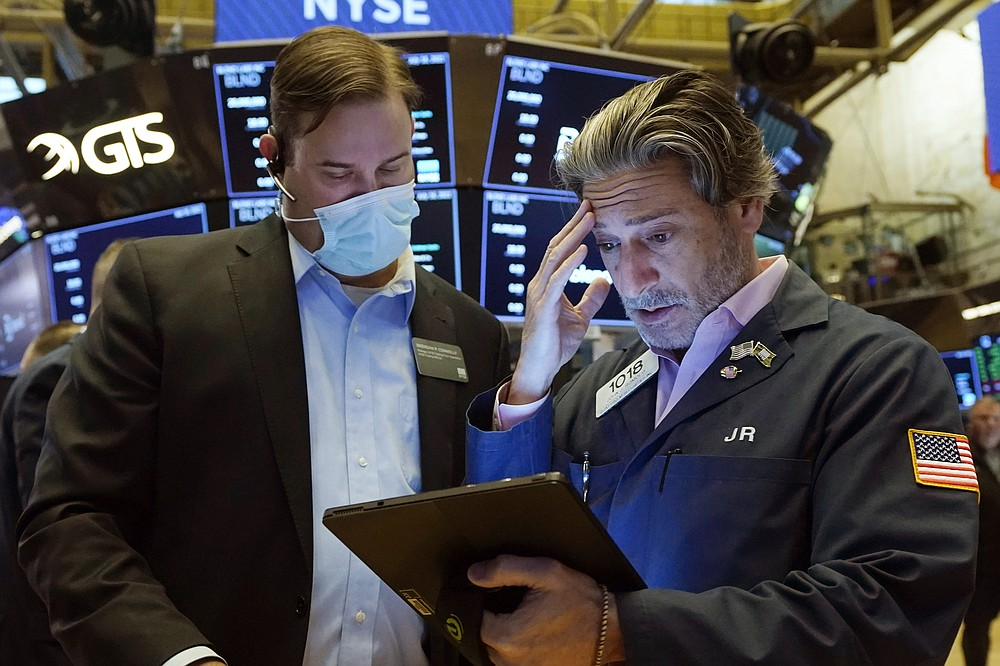 Floor Official Brendan Connolly, left, and trader John Romolo confer on the floor of the New York Stock Exchange, Friday, July 16, 2021. Stocks are off to a slightly higher start on Wall Street Friday with an assist from several big technology companies. (AP Photo/Richard Drew)