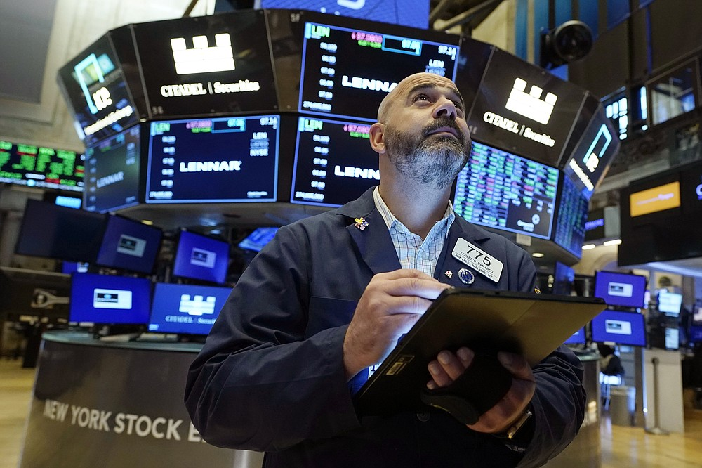 Trader Fred DeMarco works on the floor of the New York Stock Exchange, Friday, July 16, 2021. Stocks are off to a slightly higher start on Wall Street Friday with an assist from several big technology companies. (AP Photo/Richard Drew)