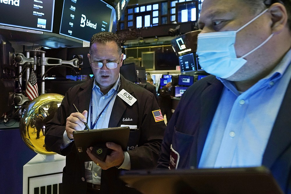 Trader Edward Curran, left, works on the floor of the New York Stock Exchange, Friday, July 16, 2021. Stocks are off to a slightly higher start on Wall Street Friday with an assist from several big technology companies. (AP Photo/Richard Drew)