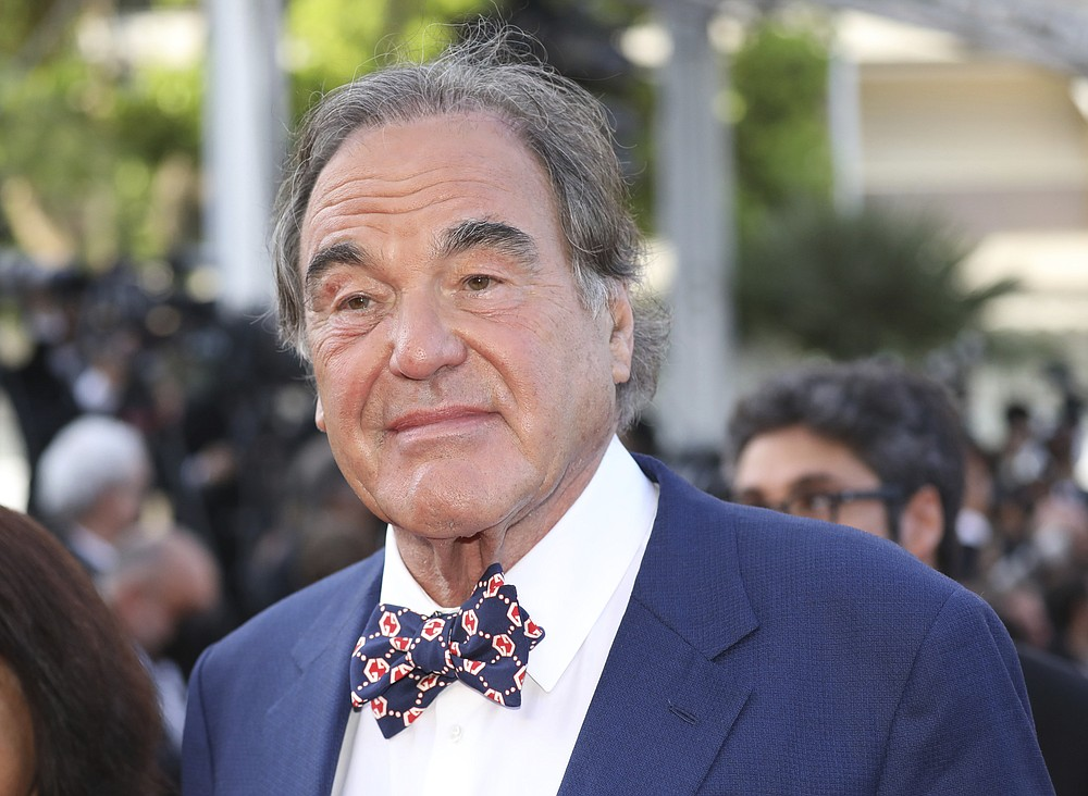 Oliver Stone poses for photographers upon arrival at the awards ceremony and premiere of the closing film 'OSS 117: From Africa with Love' at the 74th international film festival, Cannes, southern France, Saturday, July 17, 2021. (Photo by Vianney Le Caer/Invision/AP)