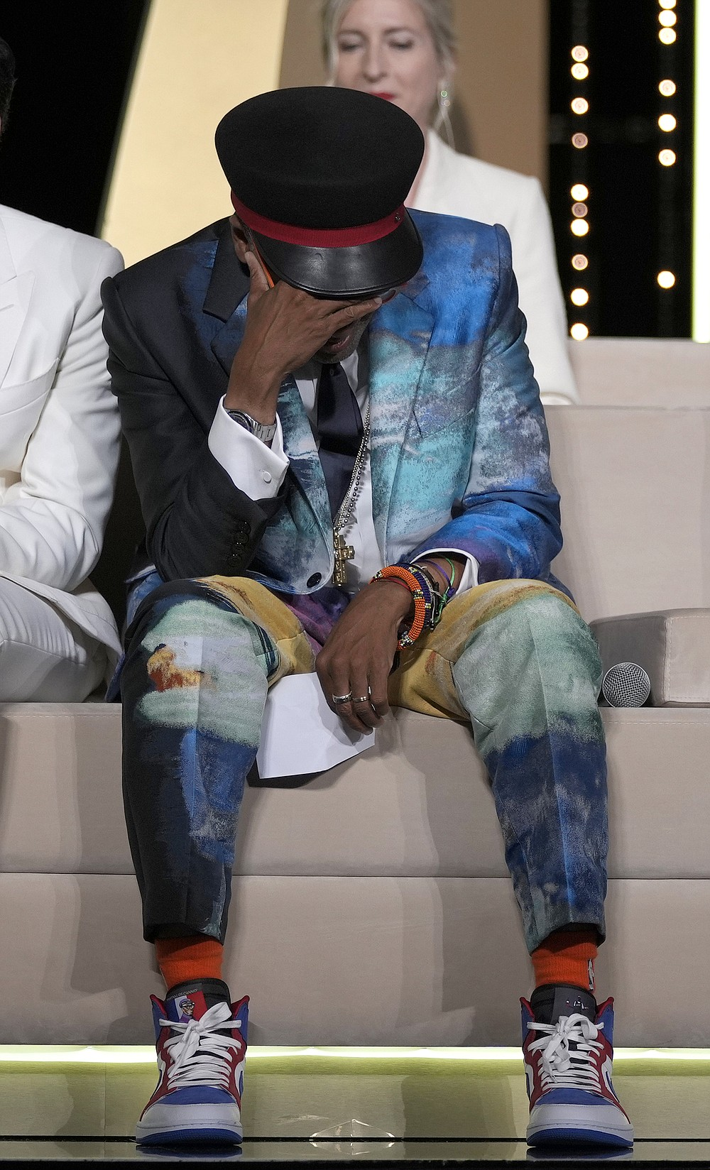 Jury president Spike Lee holds his head in hands after accidentally revealing the film 'Titane' as the winner of the Palme d'Or during the awards ceremony at the 74th international film festival, Cannes, southern France, Saturday, July 17, 2021. (AP Photo/Vadim Ghirda)