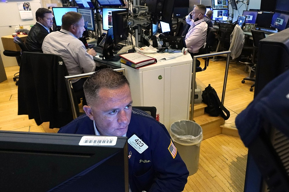 Trader Justin Flinn, foreground, works on the floor of the New York Stock Exchange, Monday, July 19, 2021. Stocks are falling sharply Monday as worries sweep from Wall Street to Sydney that the worsening pandemic in hotspots around the world will derail what's been a strong economic recovery. (AP Photo/Richard Drew)