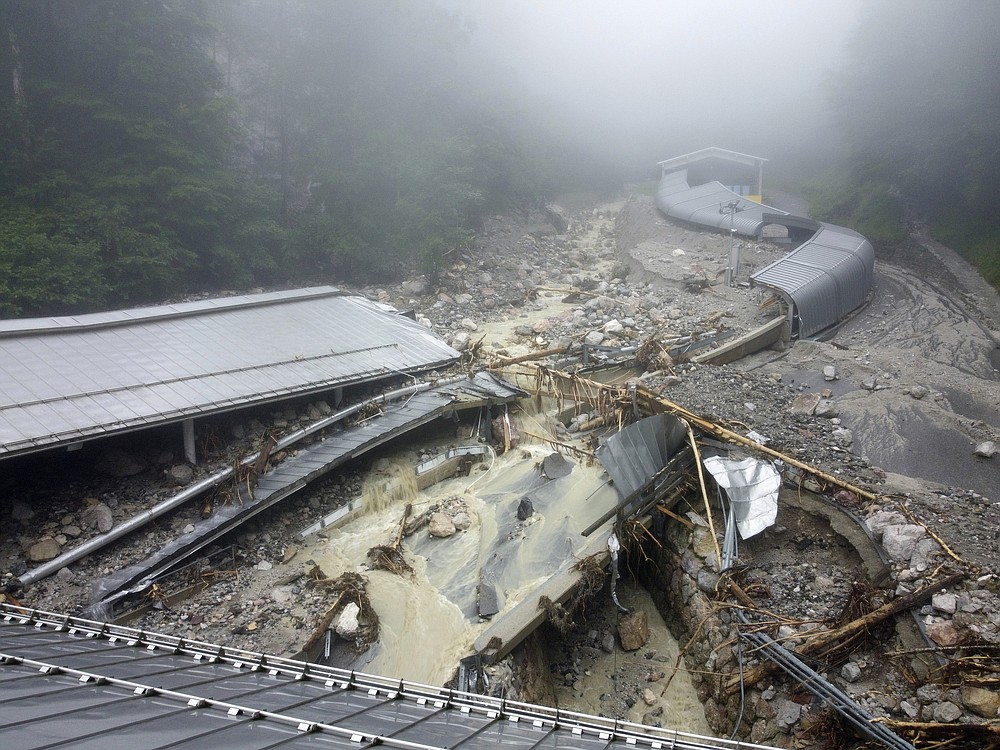 The bobsleigh and luge track is completely destroyed by debris due to the severe storm in the night of July 18, in Konigssee, Germany, Monday, July 19, 2021. (Peter Kneffel/dpa via AP)