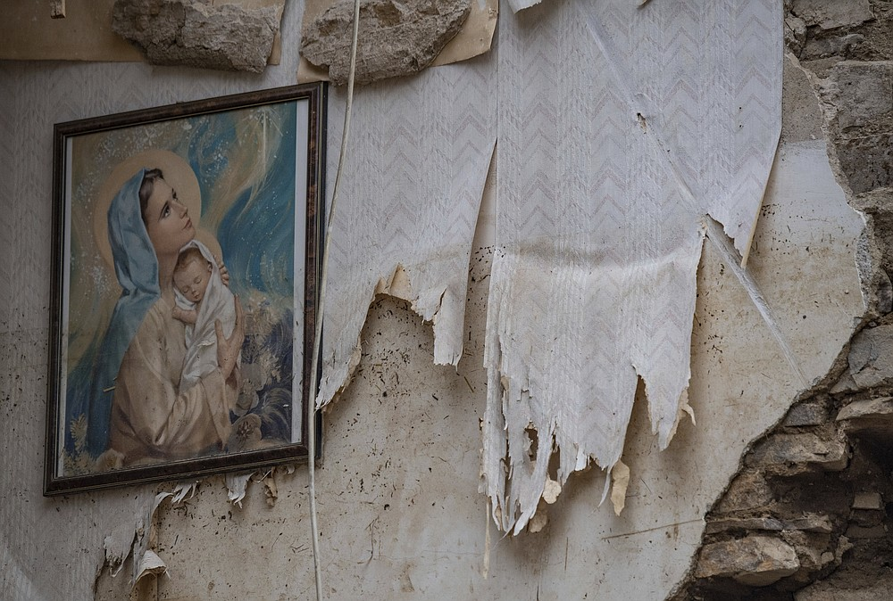 A picture of St Mary hangs in the attic of a house in Altenahr, Germany, Monday, July 19, 2021. Numerous houses in the town were completely destroyed or severely damaged, there are numerous fatalities. (Boris Roessler/dpa via AP)