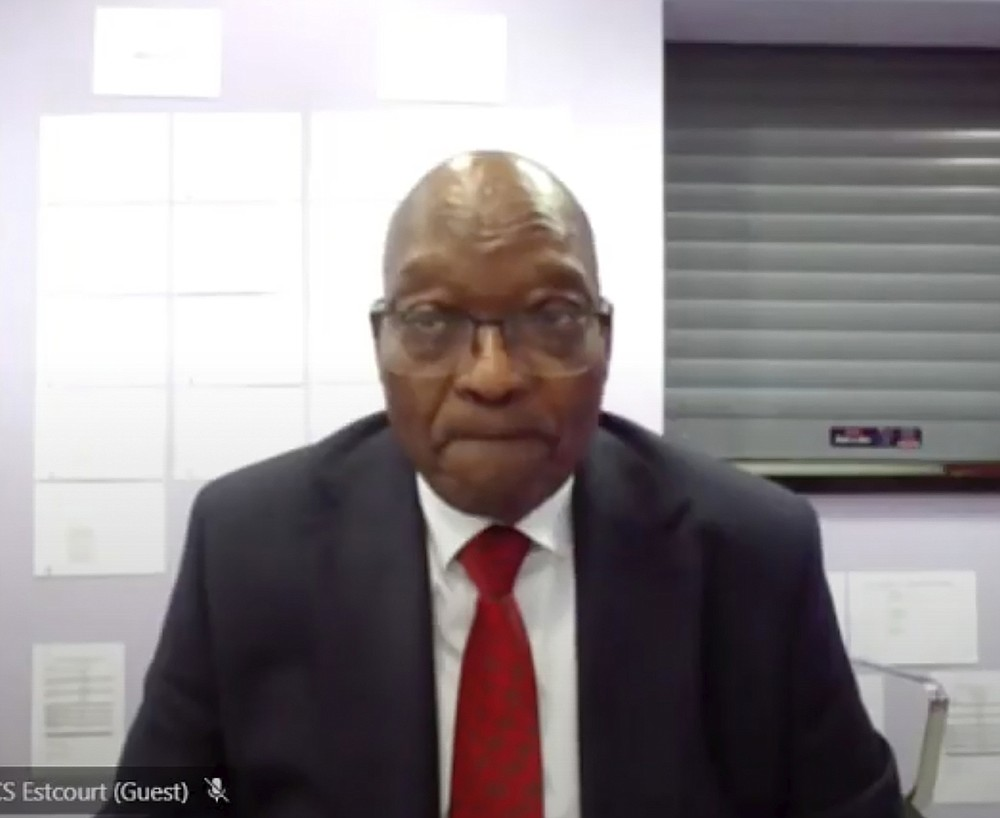In this Frame grab former South Africa President Jacob Zuma, appears on a screen virtually from the correctional service facility Estcourt, in Pietermaritzburg, South Africa, Monday July 19, 2021, where his corruption trial resumes. The trial continued more than a week after Zuma's imprisonment for contempt of court in a separate case set off rioting. (South Africa Judiciary via AP)