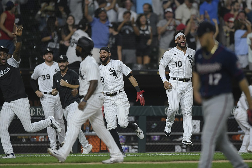 Chicago White Sox players celebrate after Gavin Sheets hit a walk-off three-run home run to defeat the Minnesota Twins in a baseball game Monday, July 19, 2021, in Chicago. (AP Photo/Paul Beaty)
