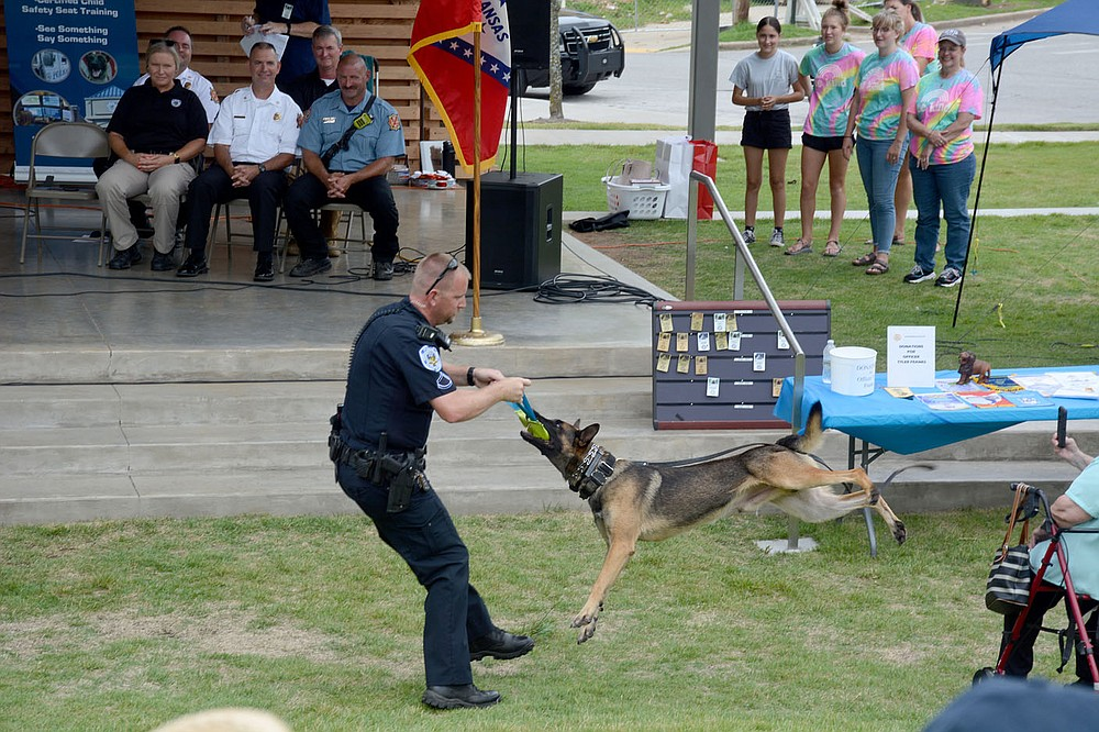 """Graham Thomas/Herald-Leader Police officer Corey Jackson and K9 Lorde give a demonstration Saturday at the """"Celebrating Siloam Springs First Responders"""" program hosted by the Siloam Springs Rotary Club at the Chautauqua Amphitheater in Memorial Park."""