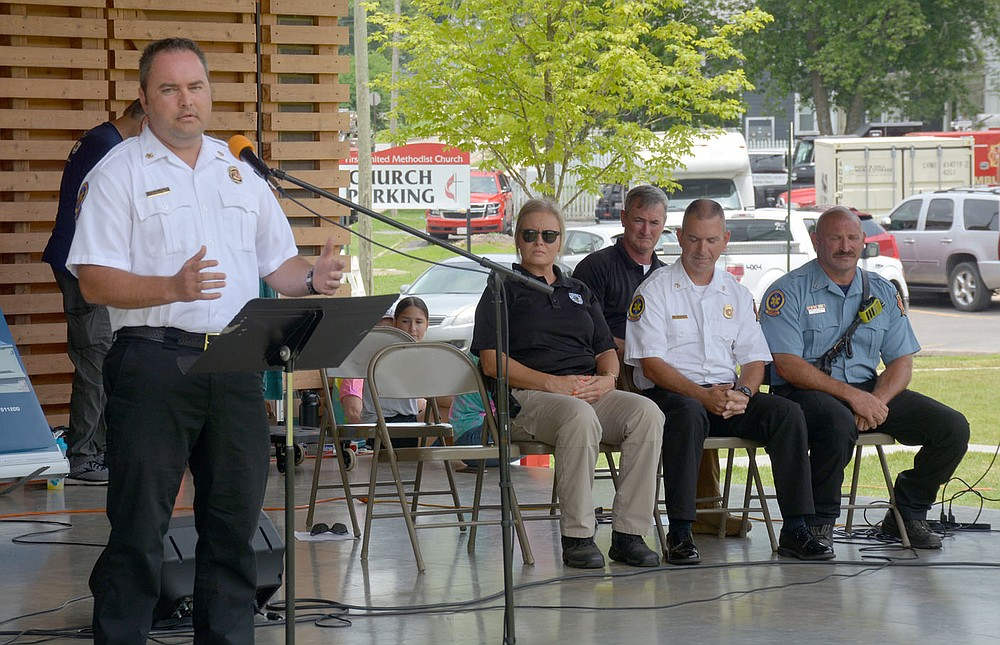 """Graham Thomas/Herald-Leader Siloam Springs Fire Chief Jeremey Criner speaks during the """"Celebrating Siloam Springs First Responders"""" program hosted by the Siloam Springs Rotary Club on Saturday at the Chautauqua Amphitheater in Memorial Park."""