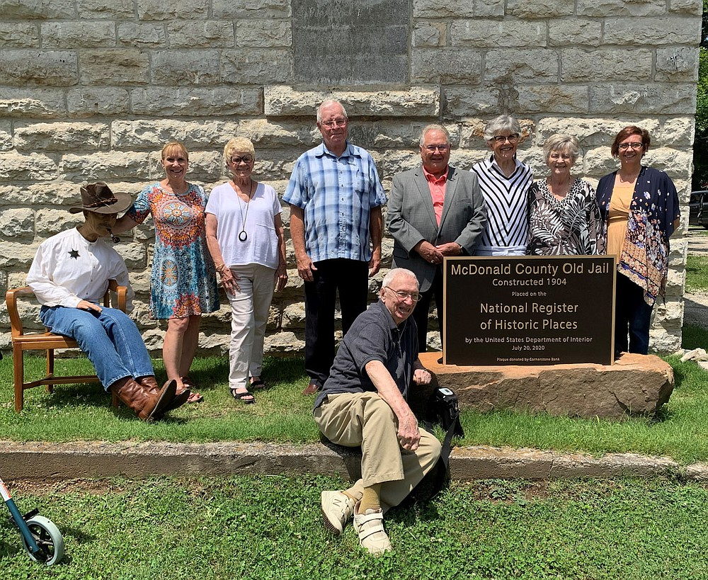ALEXUS UNDERWOOD/SPECIAL TO MCDONALD COUNTY PRESS Pictured are community members, historical society members, and volunteers that were a part of the process of the McDonald County Old Jail being added to the National Register of Historical Places. The late Gene Hall is not pictured, although he played an instrumental role in naming the jail a historic location.