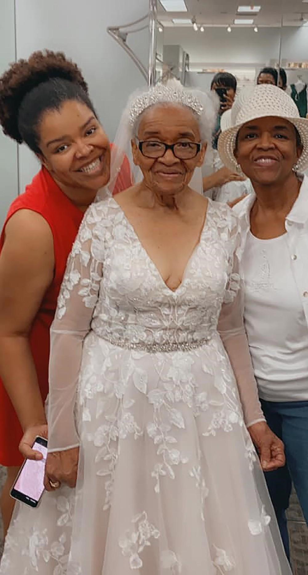 Tucker with her granddaughter Angela Strozier, left, and her eldest daughter, Rita Tucker. MUST CREDIT: Erica Tucker.
