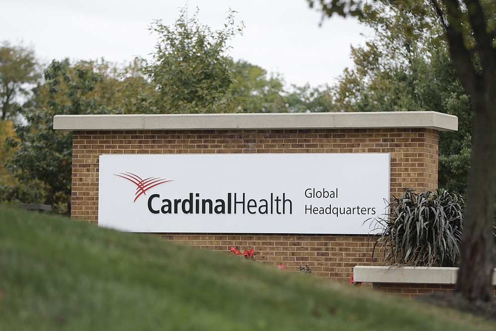 FILE - This Oct. 16, 2019, file photo shows a sign of the Cardinal Health, Inc. corporate office in Dublin, Ohio.  A $26 billion settlement between the three biggest U.S. drug distribution companies and drugmaker Johnson & Johnson and thousands of states and municipalities that sued over the toll of the opioid crisis is certainly significant, but it is far from tying a neat bow on the tangle of still unresolved lawsuits surrounding the epidemic. (AP Photo/Darron Cummings, File)