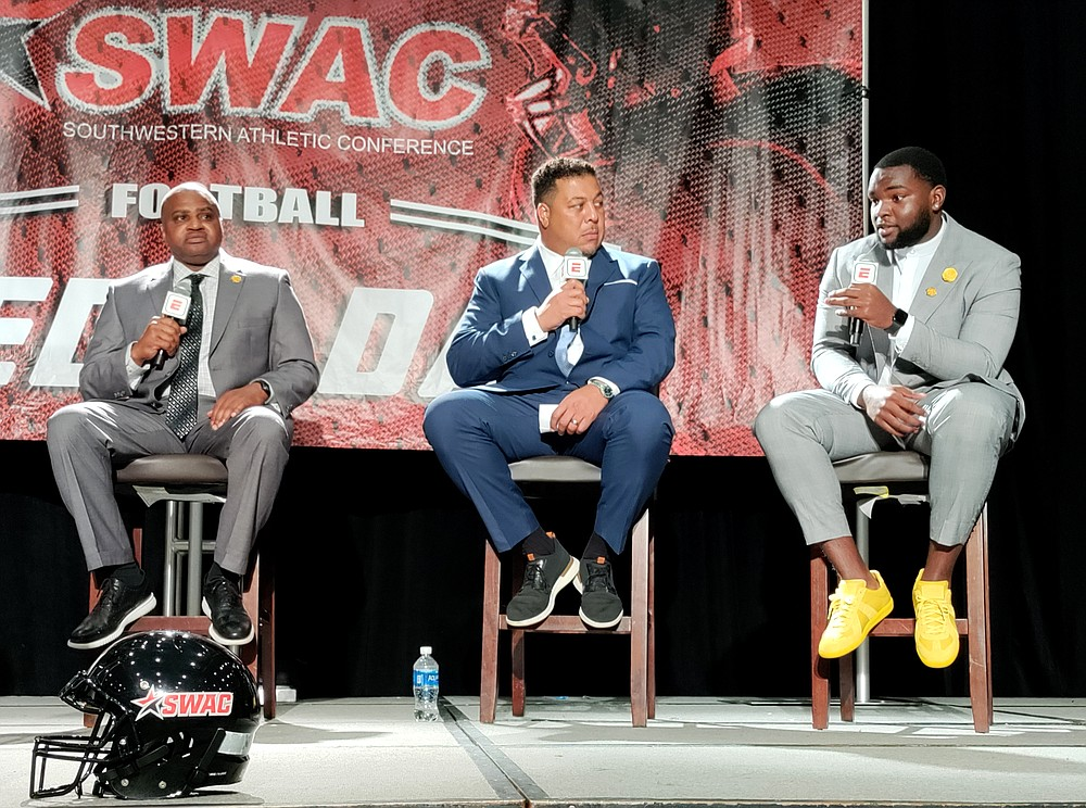 From left, UAPB Coach Doc Gamble, ESPN analyst Jay Walker and UAPB offensive lineman Mark Evans II chat on stage during a live broadcast of SWAC Media Day in Birmingham, Ala., on Tuesday. (Pine Bluff Commercial/I.C. Murrell)