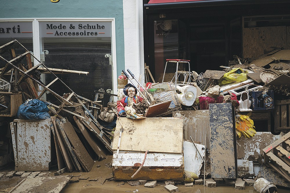 A pile of rubbish is seen in the town Bad Neuenahr-Ahrweiler, Germany, Monday July 19, 2021. More than 180 people died when heavy rainfall turned tiny streams into raging torrents across parts of western Germany and Belgium, and officials put the death toll in Ahrweiler county alone at 110. (AP Photo/Bram Janssen)