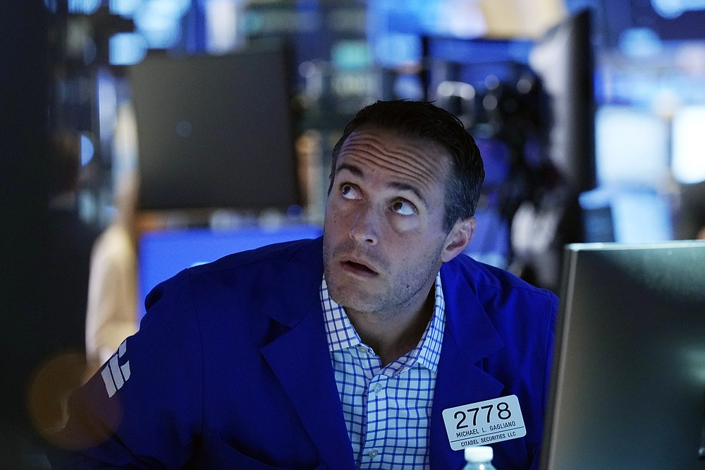 Specialist Michael Gagliano works at his post on the New York Stock Exchange trading floor on Tuesday, July 20, 2021. Stocks open higher on Wall Street Tuesday as investors shed a rout one day earlier sparked by concerns about the spread of a more contagious variant of COVID-19.  (AP Photo / Richard Drew)