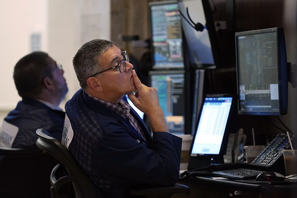 Trader Paul Slimkowski works on the trading floor of the New York Stock Exchange on Tuesday, July 20, 2021. Stocks open higher on Wall Street Tuesday as investors shed a rout a day earlier sparked by concerns about the spread of a more contagious variant of COVID-19.  (AP Photo / Richard Drew)