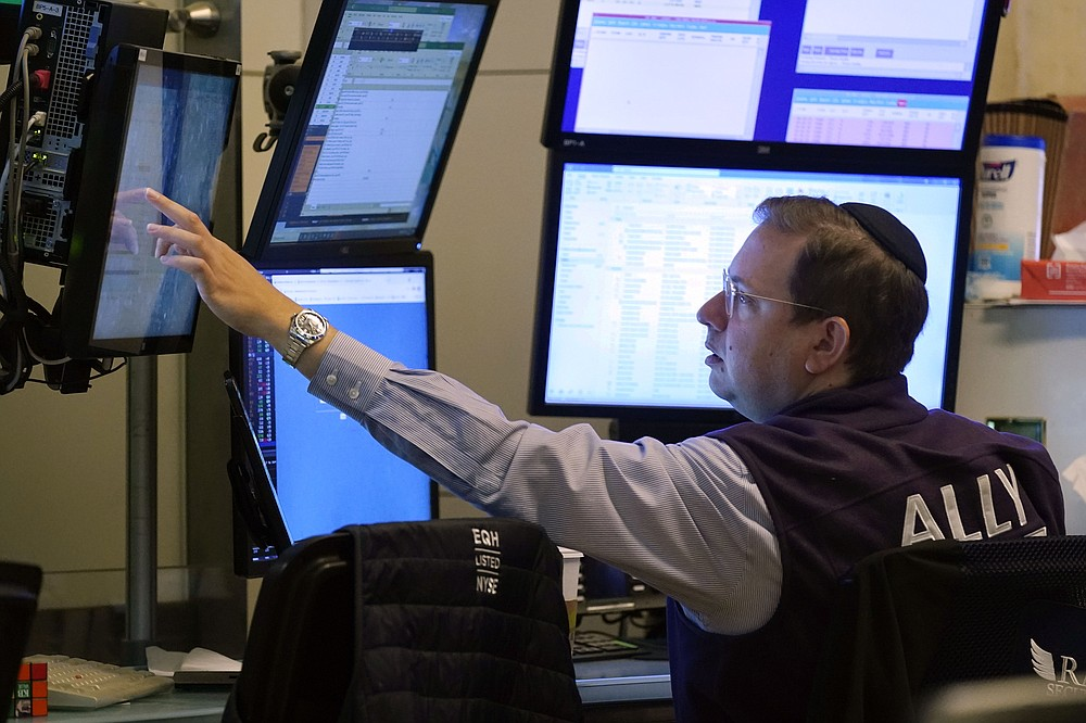 Trader Michael Bercovici works the floor of the New York Stock Exchange, Tuesday, July 20, 2021. Stocks are opening higher on Wall Street Tuesday as investors shake off a rout a day earlier brought on by concerns about the spread of a more contagious variant of COVID-19. (AP Photo/Richard Drew)