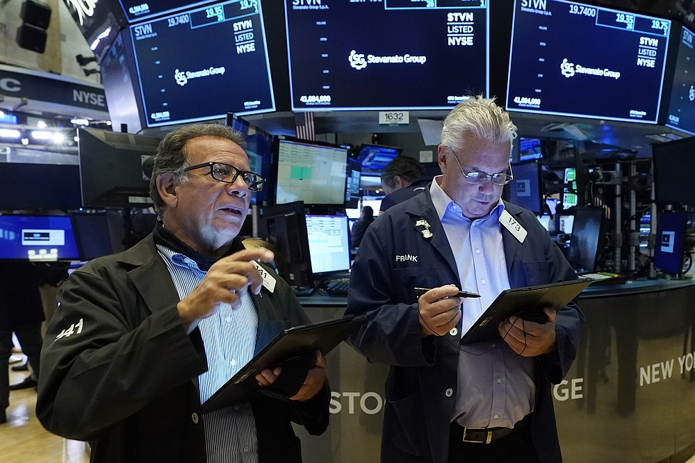 Traders Sal Suarino, left, and Frank O'Connell work on the New York Stock Exchange floor on Tuesday, July 20, 2021. Stocks open higher on Wall Street Tuesday as investors clear a rout a day earlier caused by concerns about the spread of a more contagious variant of COVID-19.  (AP Photo / Richard Drew)