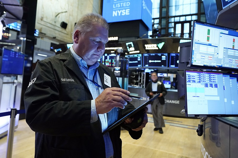 Trader George Ettinger works on the floor of the New York Stock Exchange on Tuesday, July 20, 2021. Stocks open higher on Wall Street Tuesday as investors shed a rout a day earlier sparked by concerns about the spread of a more contagious variant of COVID-19.  (AP Photo / Richard Drew)