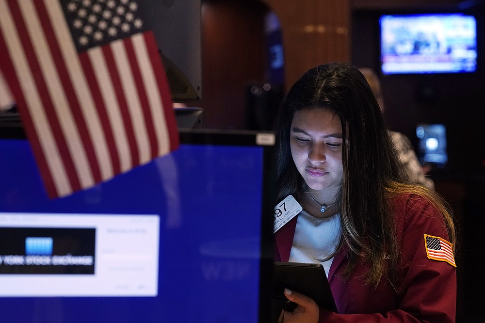 Trader Ashley Lara works on the floor of the New York Stock Exchange, Tuesday, July 20, 2021. Stocks are opening higher on Wall Street Tuesday as investors shake off a rout a day earlier brought on by concerns about the spread of a more contagious variant of COVID-19. (AP Photo/Richard Drew)