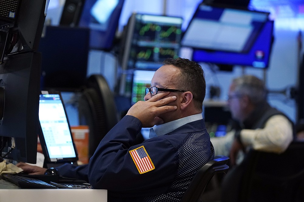 A trader works on the floor of the New York Stock Exchange, Tuesday, July 20, 2021. Stocks are opening higher on Wall Street Tuesday as investors shake off a rout a day earlier brought on by concerns about the spread of a more contagious variant of COVID-19. (AP Photo/Richard Drew)