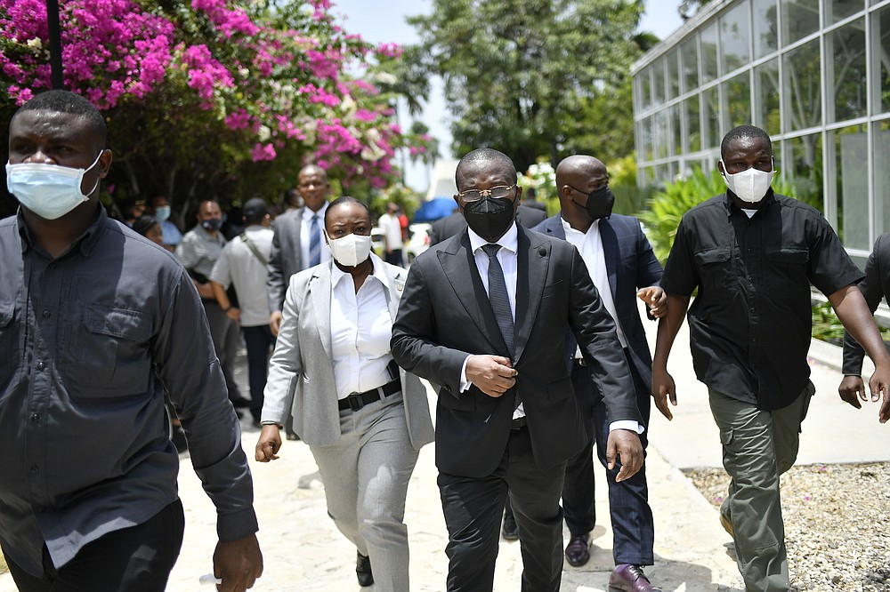 Interim Prime MinisterClaude Joseph leaves a memorial service for late Haitian President Jovenel Moise at the National Pantheon Museum in Port-au-Prince, Haiti, Tuesday, July 20, 2021. Designated Prime Minister Ariel Henry is expected to be sworn in later in the day to replace Joseph, who assumed leadership of Haiti with the backing of police and the military after the July 7 attack at Moïse's private home. (AP Photo/Matias Delacroix)