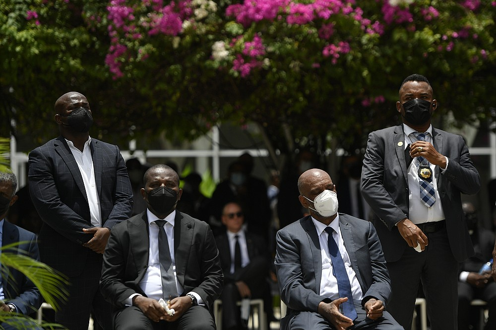 Interim Prime MinisterClaude Joseph, sitting left, and designated Prime Minister Ariel Henry attend a memorial service for late Haitian President Jovenel Moise at the National Pantheon Museum in Port-au-Prince, Haiti, Tuesday, July 20, 2021. Henry is expected to be sworn in later in the day to replace Joseph, who assumed leadership of Haiti with the backing of police and the military after the July 7 attack at Moïse's private home. (AP Photo/Matias Delacroix)