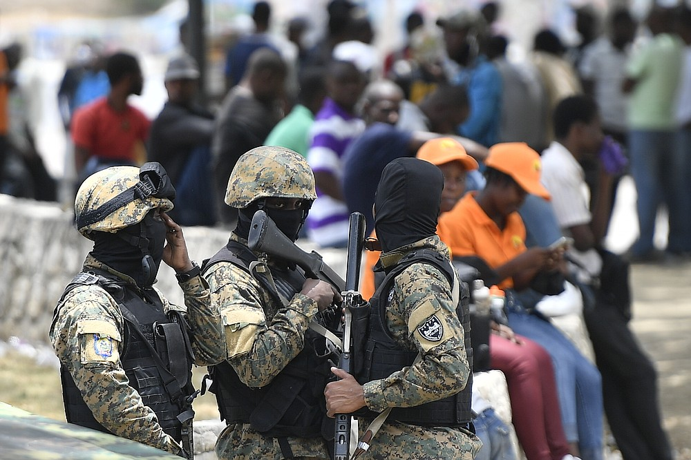 Security forces stand outside the National Pantheon Museum during a memorial ceremony for the late Haitian President Jovenel Moise in Port-au-Prince, Haiti, Tuesday, July 20, 2021. Moise was assassinated at home on July 7. (AP Photo/Matias Delacroix)