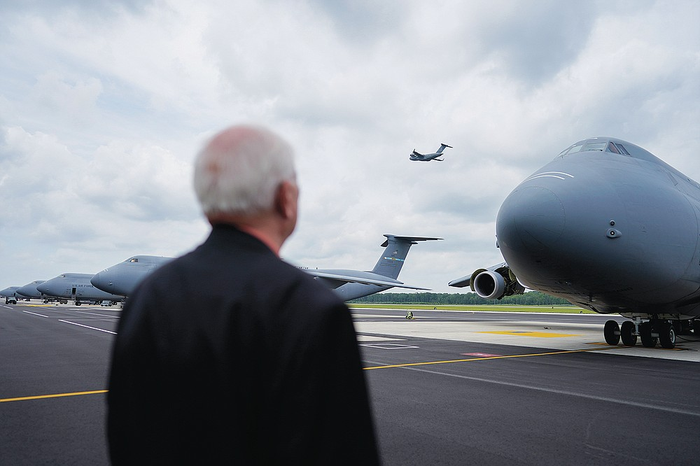 Air Force Mortuary Affairs Operations Senior Chaplain David Sparks looks at a C-5M Super Galaxy transport plane on the flightline at Dover Air Force Base, Del., Monday, June 21, 2021. The aircraft is one of those used for the dignified transfer of remains, conducted upon arrival at Dover Air Force Base to honor those who have died while serving in a military theater of operations. (AP Photo/Carolyn Kaster)
