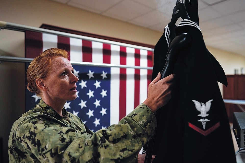 Chief Hospital Corpsman, United States Fleet Marine Forces, Jessica Zugzda steams a dress Navy uniform in the uniform shop of the Air Force Mortuary Affairs Operations center at Dover Air Force Base, Del., Friday, July 9, 2021. The uniform shop is where dress uniforms are prepared so a slain service member can be dressed perfectly one last time. (AP Photo/Carolyn Kaster)