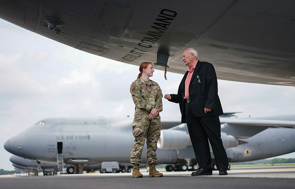 Air Force Mortuary Affairs Operations Senior Chaplain David Sparks talks with Airman 1st Class Cydney Lee, left, while under a C-5M Super Galaxy aircraft on the flightline at Dover Air Force Base, Del., Monday, June 21, 2021. The C-5M Super Galaxy is one of the aircraft used for dignified transfer of remains, conducted upon arrival at Dover Air Force Base to honor those who have died while serving in a military theater of operations. (AP Photo/Carolyn Kaster)