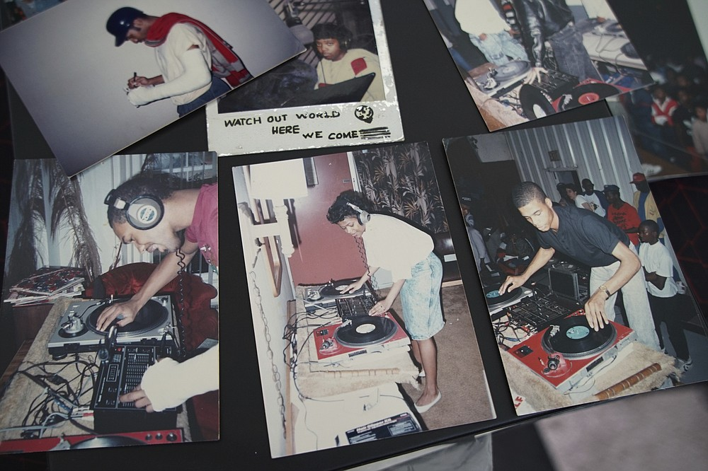 Old photos of Alton Lucas, top and bottom on left, and musician DJ Nabs, lower right, are assembled in a scrapbook in Nabs' home studio outside of Raleigh, N.C., on Saturday, June 26, 2021. As a teenager, Lucas believed basketball or music would pluck him out of North Carolina and take him around the world. In the late 1980s, he was already the right-hand man to his musically inclined best friend, Youtha Anthony Fowler, who many hip-hop and R&B heads know today as DJ Nabs. (AP Photo/Allen G. Breed)